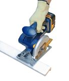 Cutting wood with electric saw Royalty Free Stock Photo