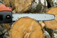 Cutting wood with gas chain saw Royalty Free Stock Image