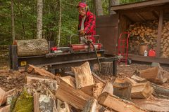 Cutting wood with a log splitter Stock Images