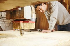 Cutting wood using a machine with numerical control. Cnc tool. Woodworking industry stock photo