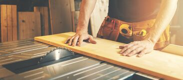 Free Cutting Wooden Board On A Table Saw. Woodworking And Carpentry. Furniture Manufacturing Royalty Free Stock Photos - 214739268