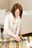 Cutting wrapping paper Royalty Free Stock Photo