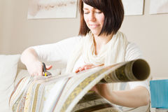 Cutting wrapping paper royalty free stock photography