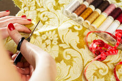 Cutting the yellow silk cloth Royalty Free Stock Photography