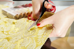 Cutting the yellow silk cloth Royalty Free Stock Photos