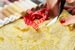 Cutting the yellow silk cloth Stock Photography