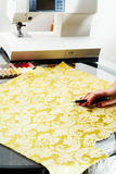 Cutting the yellow silk cloth Stock Photos