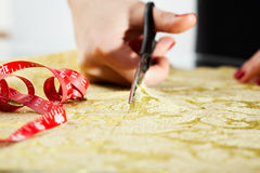 Cutting the yellow silk cloth Royalty Free Stock Image