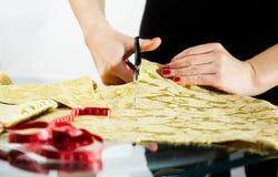 Cutting the yellow silk cloth Royalty Free Stock Photos