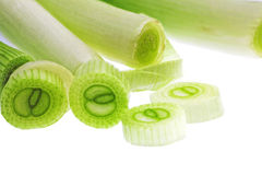 Cutting young onion on white background. Close-Up.  Stock Photography
