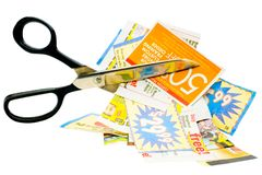 Cuttings of newspaper with scissors Stock Images
