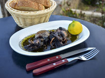 Cuttlefish grilled in ink with lemon Stock Photo