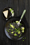 Cuttlefish ink spaghetti with broccoli Royalty Free Stock Photo