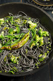 Cuttlefish ink spaghetti Stock Images