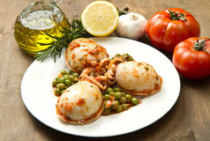 Cuttlefish with peas stock photos