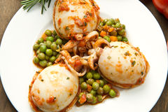 Cuttlefish with peas stock images