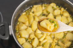 Cuttlefish stew with potatoes and peas series 12 Stock Photo
