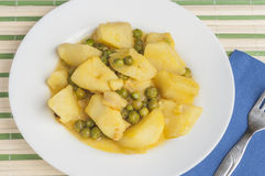 Cuttlefish stew with potatoes and peas series 09 Stock Images