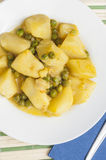 Cuttlefish stew with potatoes and peas series 07 Stock Photos