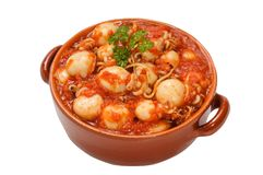 Cuttlefish with tomato sauce. In the stone pan Stock Image