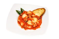 Cuttlefish with tomato sauce. In white dish Royalty Free Stock Photos