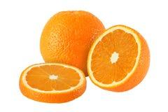 Cutvand hela apelsinfrukter som isoleras på vit bakgrund Fotografering för Bildbyråer