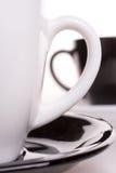 Cuvette blanche et noire de thé Photo stock