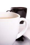 Cuvette blanche et noire de thé Photos libres de droits