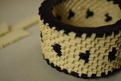 Cuvette crème et noire d'origami Photographie stock libre de droits
