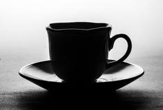 Cuvette de café au-dessus du fond blanc Images stock