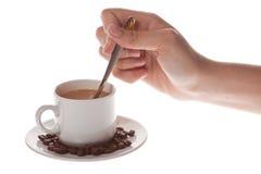 Cuvette de café avec la cuillère Images stock