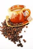 Cuvette de café avec le grain de café Photographie stock libre de droits