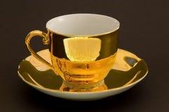 Cuvette de café d'or Image stock