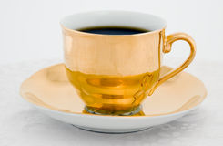 Cuvette de café d'or Images stock