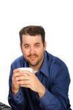 Cuvette de café de fixation d'homme d'affaires Image stock