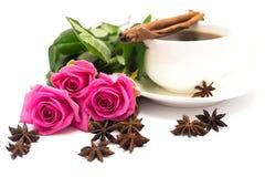 Cuvette de café et de roses Images stock