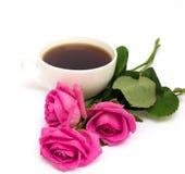 Cuvette de café et de roses Photo stock