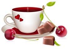 Cuvette de chocolats et de ri en forme de coeur de thé (café) Photographie stock libre de droits