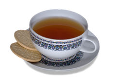 Cuvette de thé avec des biscuits Images stock