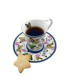 Cuvette de thé avec un biscuit sous forme d'étoile Photographie stock libre de droits