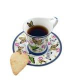 Cuvette de thé avec un biscuit sous forme de coeur Photos stock