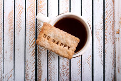 Cuvette de thé et de biscuit Photos stock