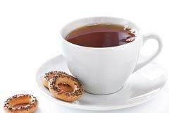 Cuvette de thé et de biscuits chauds Images libres de droits