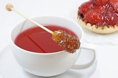 Cuvette de thé rouge Photographie stock libre de droits