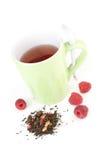 Cuvette de thé vert de framboise Photo stock