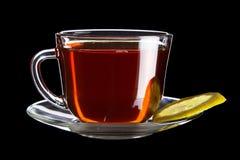 Cuvette de thé noir avec le citron Photos libres de droits