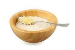Cuvette en bois avec du riz et la cuillère avec des vermicellis Photographie stock