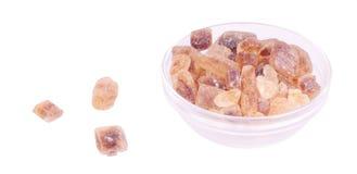 Cuvette en verre avec du sucre de sucrerie Image stock