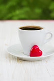 Cuvette et coeur de café Photographie stock