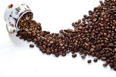 Cuvette et grains de café Images libres de droits